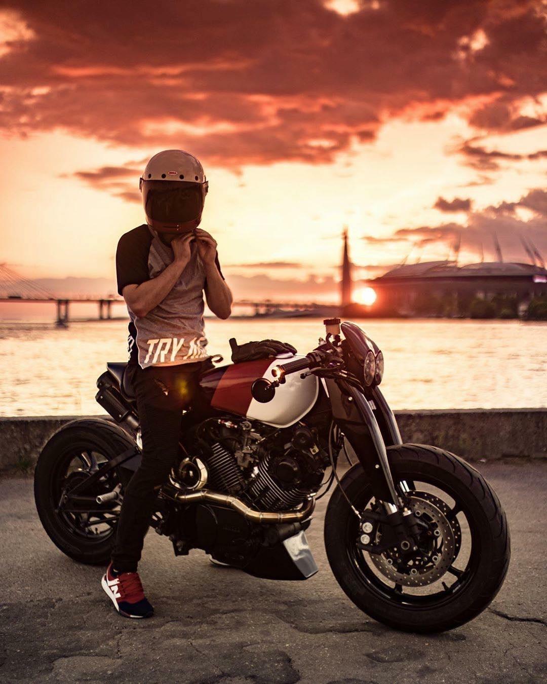man on motorcycle sunset