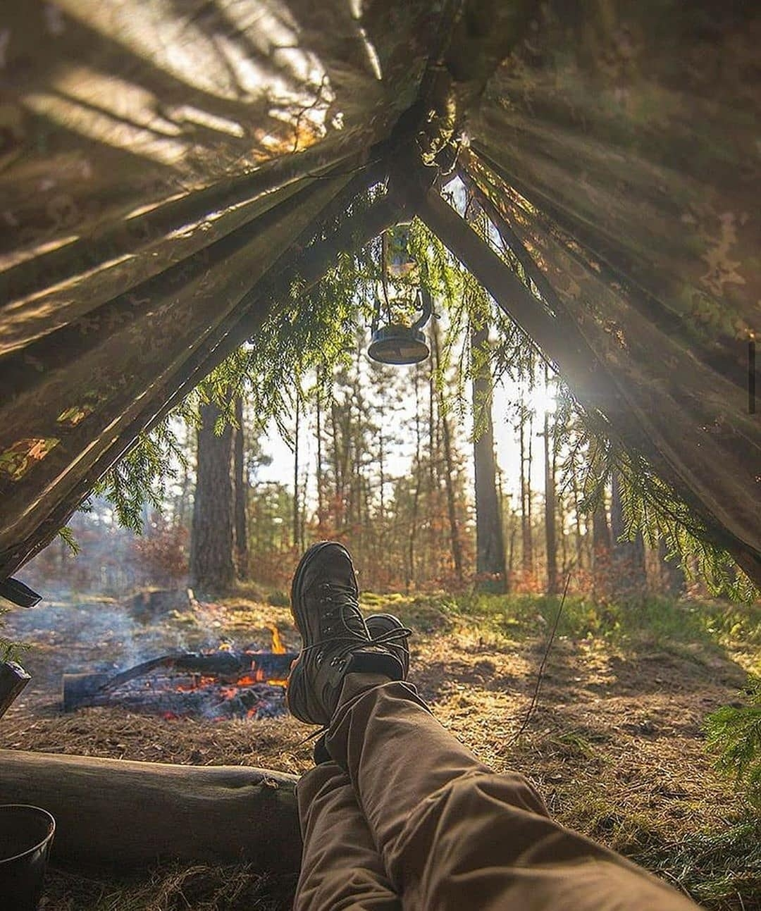 man relaxing in tent