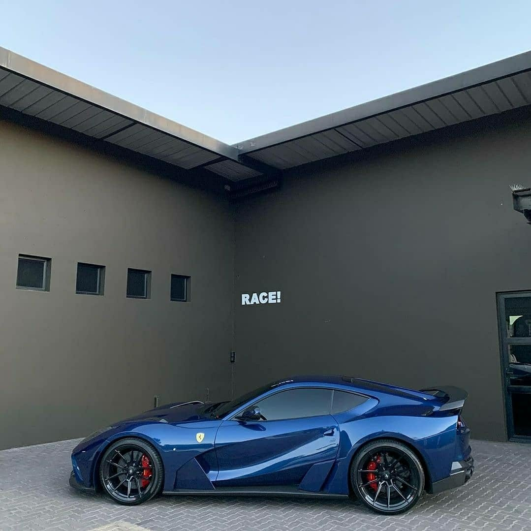 blue ferrari parked