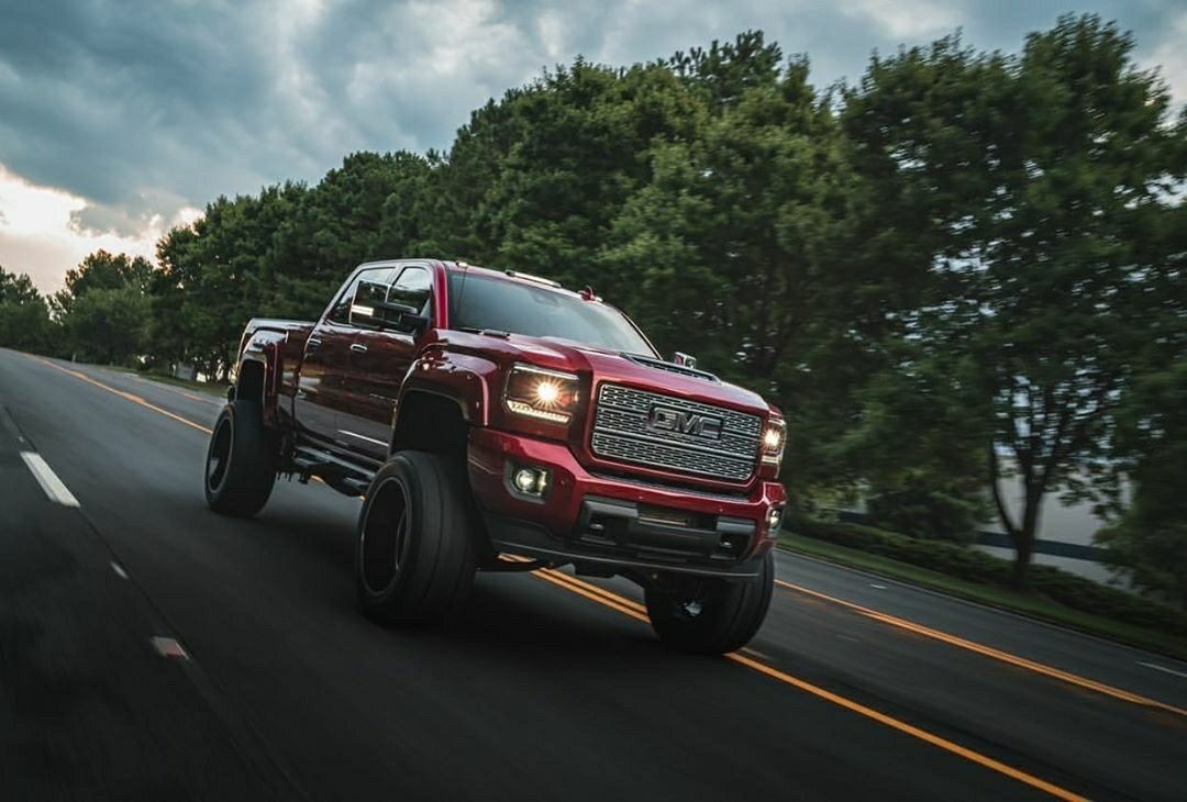 red gmc truck on highway