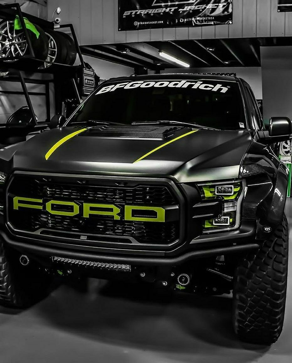 black ford raptor with green trim
